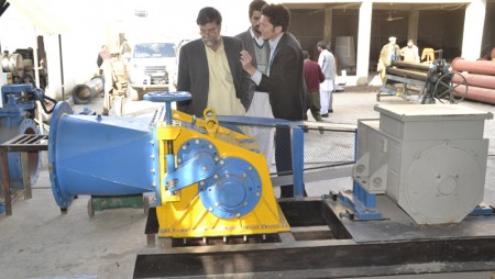 Italian Corporation Head inspecting T-15 Crossflow Turbine Manufactured by Hydrolink